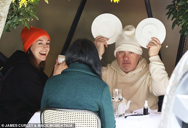 Have a chuckle: Damien Hirst and his girlfriend Sophie Cannell have proven themselves to be the fun-loving couple every moment as the iconic artist has been seen playing the fool over a fancy meal at Scott Restaurant with a friend Tuesday