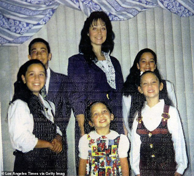 Nieves(center, back) is pictured with her four daughters, who died in the fire, and her son, who survived [File photo]
