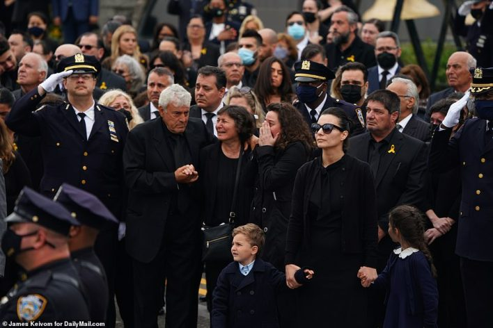 Mourners become emotional outside the church. Tsakos' wife was supported by her husband's family who flew from Greece