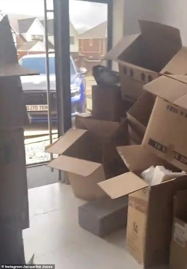 Unpacking: The former EastEnders star, 28,gave a realistic view of the workload ahead of her as she showed empty cardboard boxes stacked up at the door and rooms covered in their stuff