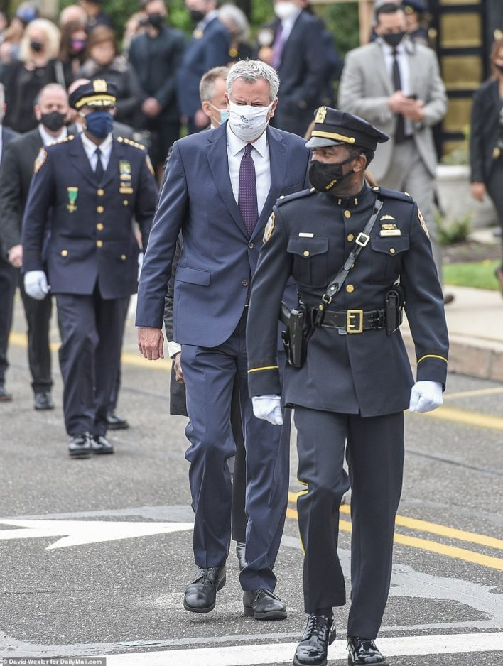 New York City Mayor Bill de Blasio also spoke at the service where he paid tribute to the fallen officer as a 'true hero'