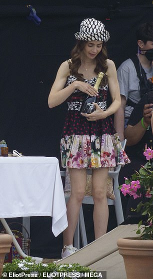 Fashion show: The actress, 32, also slipped into a colourful sundress and bucket hat