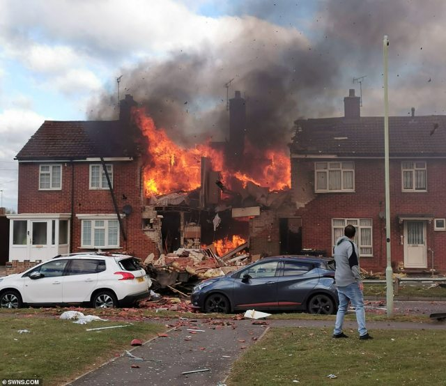 The pair, who work in construction, were driving past the house in Willesborough in Ashford, Kent, just after 8am when they witnessed the aftermath of the blast. Two people were airlifted to hospital and a further five were hurt (pictured is the house on fire after the explosion)