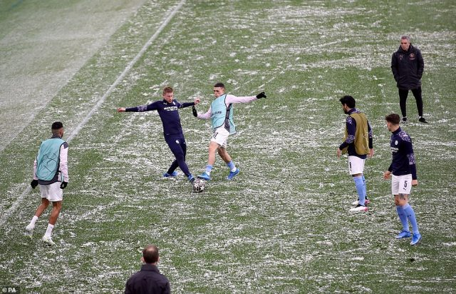 Staff used snow shovels to clear the pitch ahead of the match, but the ground could be seen under a light dusting of snow during the game