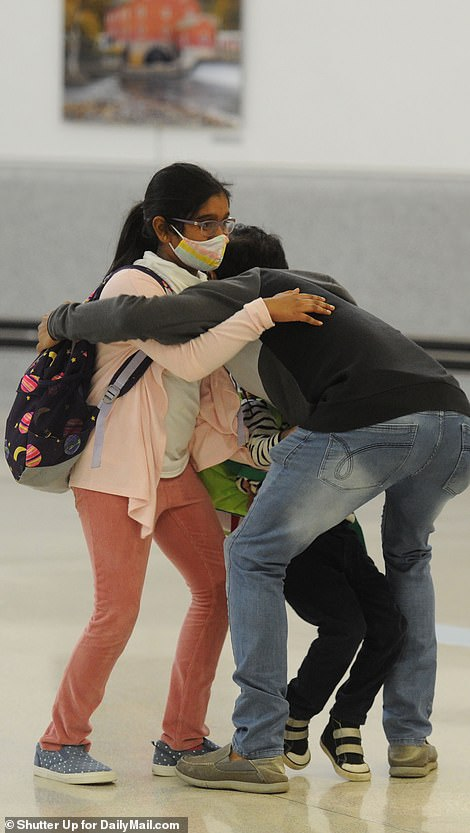 There were emotional reunions at Newark as people arrived on the flights from India, where COVID cases have surpassed 20million