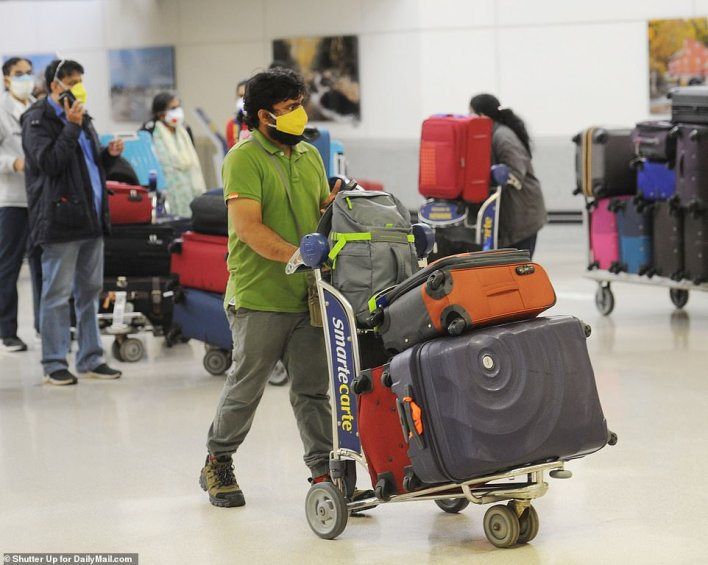 A man arrives at Newark on an Air India flight on Tuesday morning. India is experiencing the worst COVID disaster the world has seen and many are rushing to leave