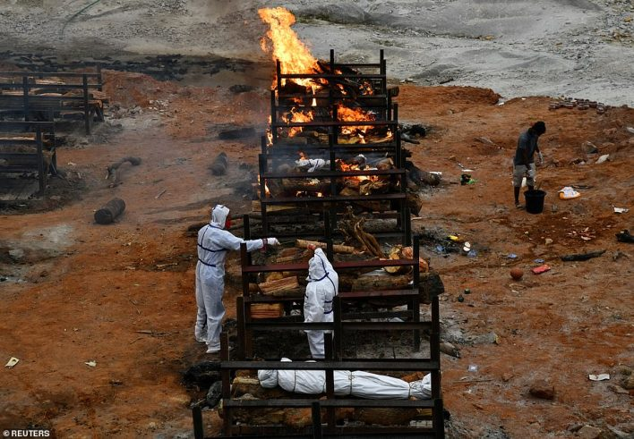Relatives cremate the body of a person who died due to the coronavirus disease (COVID-19), at a crematorium ground in Giddenahalli village on the outskirts of Bengaluru, India, May 2, 2021
