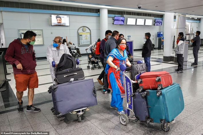 Passengers from Air India flight from New Delhi arrive at O'Hare International Airport on Tuesday, May 4, 2021 in Chicago