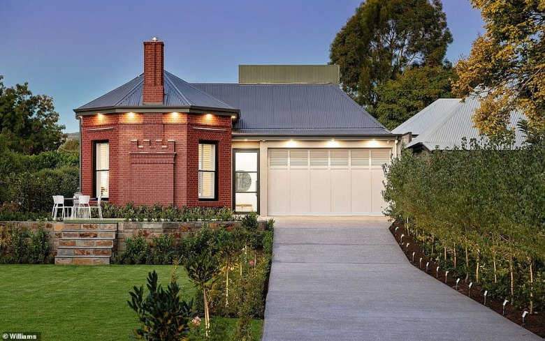 The unassuming redbrick front of one of Adelaide's oldest cottages (pictured) hides a spectacular modern home