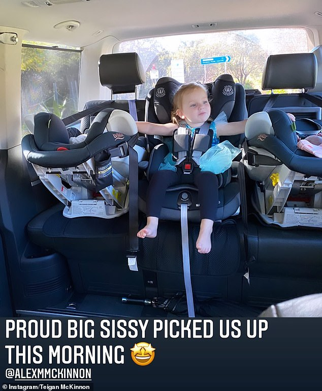 'Proud big sissy': Teigan also shared a picture of their older daughter Harriet Anne, two, next to her sisters in the car ride home from the hospital