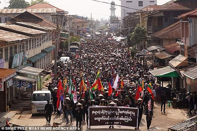 "Protesters taking part in a demonstration against the military coup on ""Global Myanmar Spring Revolution Day"" in Kyaukme in Myanmar's Shan State"
