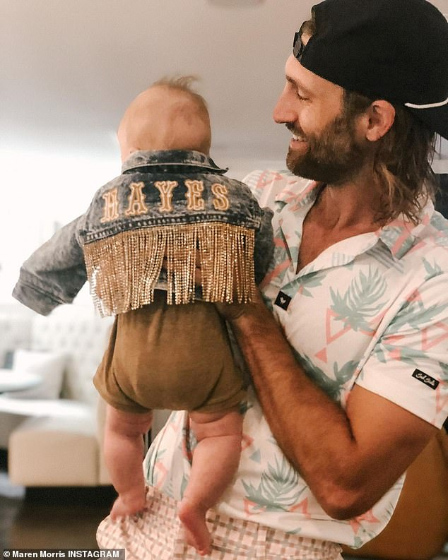 Lots of love: Morris and Hurd are doting parents to their son, whose face they don't share on social media anymore for privacy and to avoid mom shaming