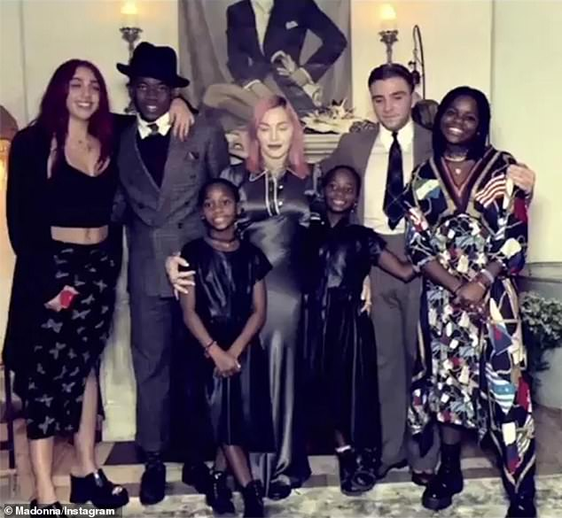 Thanksgiving Family Portrait: Madge, born in Michigan, is also a mother to son Rocco (with ex-husband # 2 Guy Ritchie), 20;  15-year-old son David;  daughter Mercy, 15;  and twin daughters Stella & Estere, 8 years old