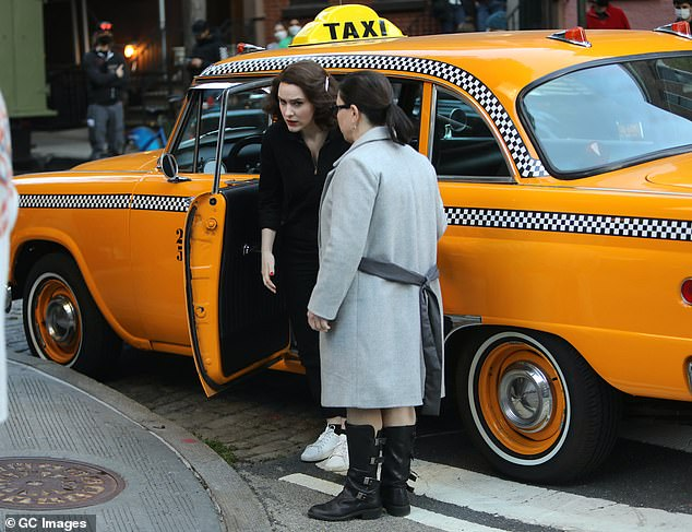 Tense: Brosnahan, who plays the titular 1950s housewife turned stand-up comedian, exited a yellow cab to be greeted by Susie Myerson, Borstein's head of streetwise talent