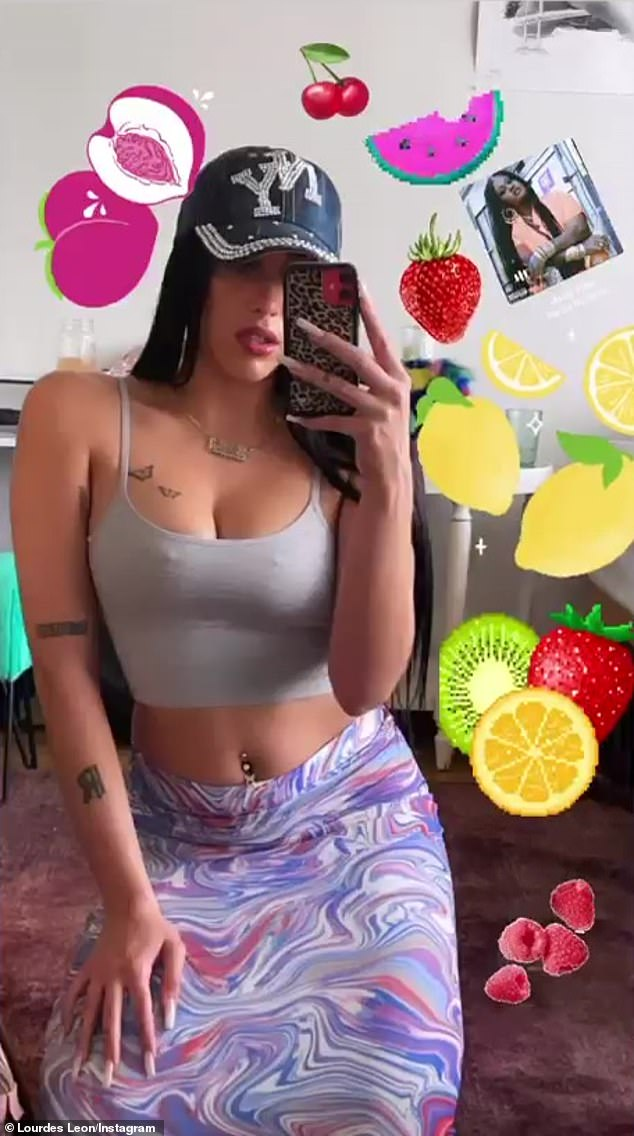 'Latin from Manhattan': Lola Leon from Lourdes showed off a substantial cleavage and retro belly piercing in a sexy selfie on Tuesday for the visual pleasure of her 127,000 Instagram followers