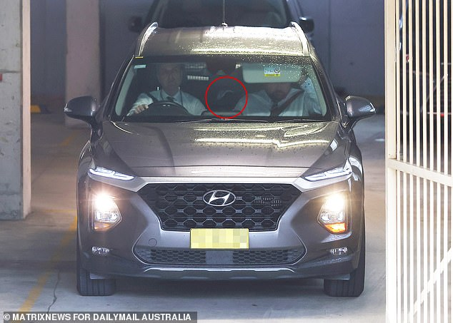 Cricket legend Stuart MacGill has been taken away by detectives to give a statement after he was allegedly assaulted and kidnapped. He was seen lying down in the back of this SUV to avoid media waiting to speak to him about the ordeal