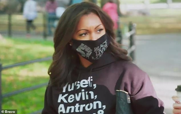 Historic debut:Eboni K. Williams made her historic debut as the first black star of The Real Housewives Of New York City on Tuesday wearing a Black Lives Matter face mask and hoodie representing the Central Park Five