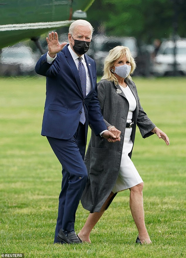 'I think he feels he actually looks better in a mask!' Trump mocked Biden for continuing to wear a mask outdoors. The President is pictured with his wife, Jill, on Monday