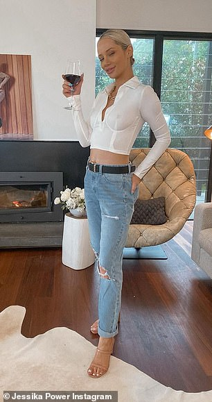 Whoops!The newly single beauty, 29, posed in a sheer white blouse while enjoying a glass of red wine - yet didn't appear to notice that her nipple was visible underneath