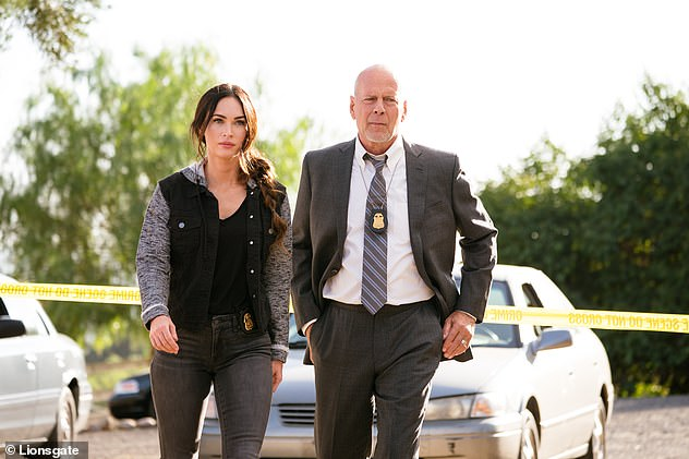 First look:It comes after the first stills from Megan's upcoming thriller Midnight In The Switchgrass were released on Friday (pictured with co-star Bruce Willis)