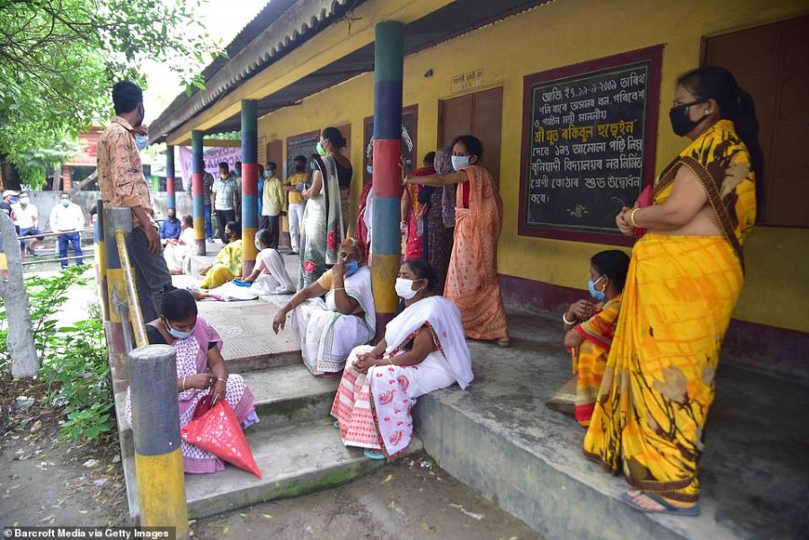 Women wait in line at a vaccination centre inAssam state, India, to get their Covid jabs - even as some states warned they have run out of doses