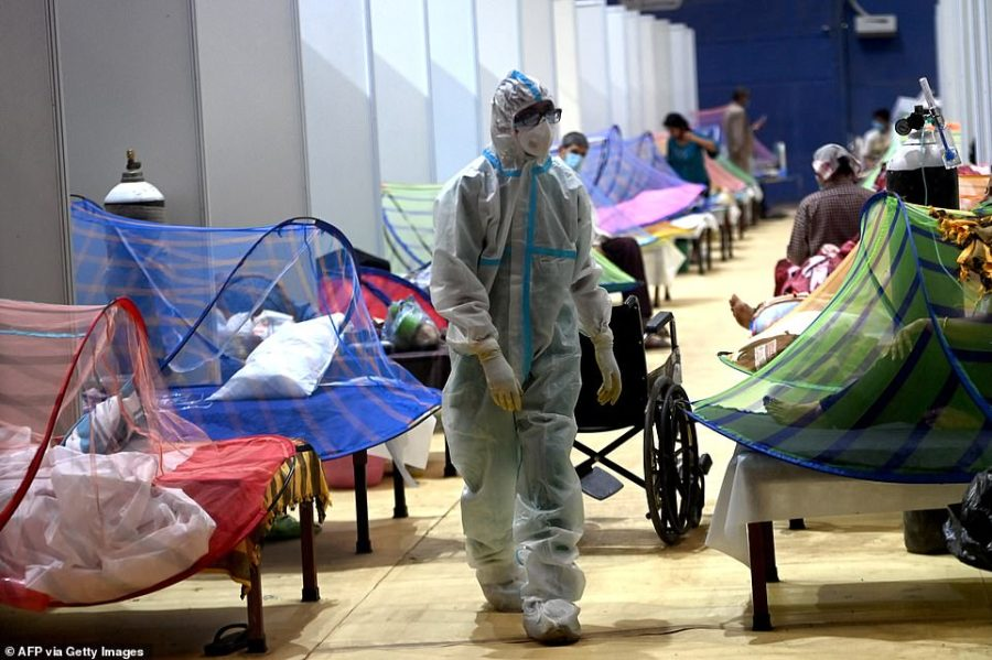 A health worker walks inside the Common Wealth Games stadium temporarily converted into the Covid-19 Coronavirus care centre in New Delhi on May 5, 2021
