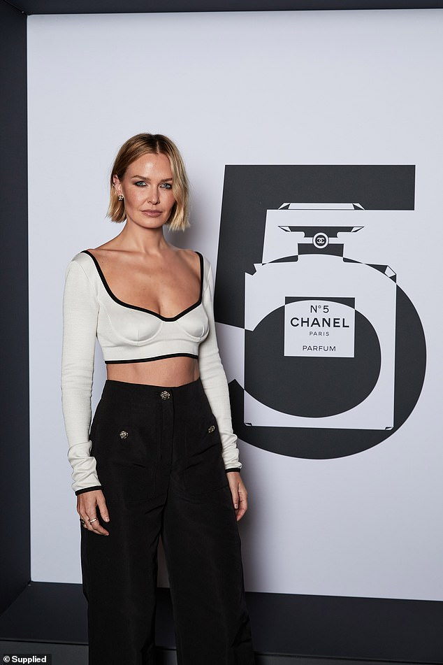 Fabulous:The model and influencer looked sexy yet elegant in a low-cut midriff top and a pair of flared, high-waisted trousers