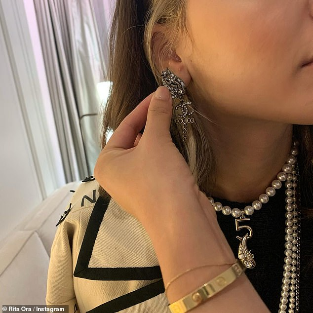 Glitzy: Rita showed off her collection of jewels for her fans, including a pair of diamond encrusted Chanel earrings