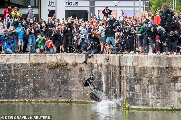 A bronze memorial to Colston was ripped down by Black Lives Matter demonstrators (pictured) in Bristol on June 7 and dumped in the city's harbour amid tensions around Britain's colonial past