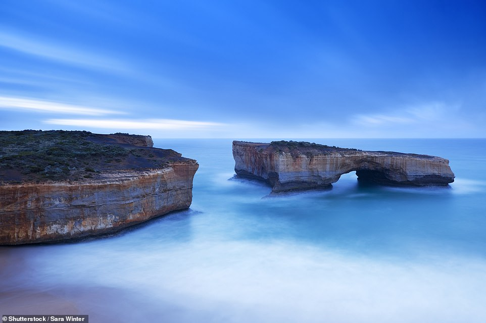The London Arch is an offshore natural arch in the Port Campbell National Park in southeast Australia. The rock formation was previously known as the London Bridge as the arch was connected to the mainland via another arch, making it look like its manmade British counterpart. However, the connecting arch collapsed in 1990 and the landmark's name was adapted. Before it collapsed, visitors could walk right to the end of the rock bridge