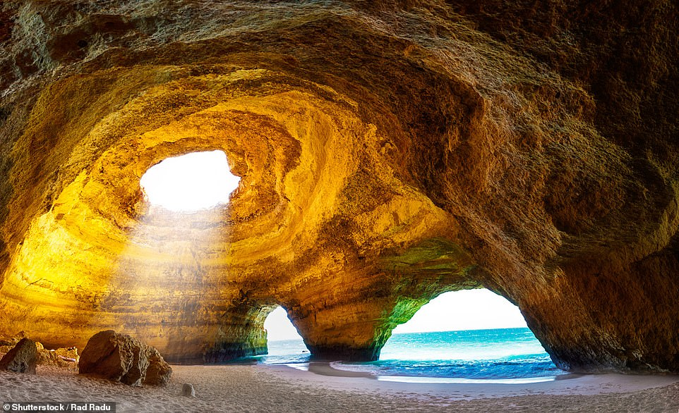 One of the most popular photography spots in Portugal is the Benagil cave. The unique rock formation, located in the Algarve between Benagil Beach and Marinha Beach, has a big holein its ceiling which means the sun casts a magical glow at certain times of the day. It is possible to swim to the cave but strong currents mean it's more advisable to take a boat tour or get there by kayak or stand up paddleboard