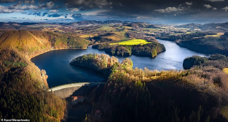 An amazing shot of Lake Pilchowickie near the town of Jelenia Gora in south-west Poland. It was created as a result of the building of theBobr Dam in 1912. Poland Travel Tours says: 'There is a railway bridge extending over the lake – it is an especially romantic place for taking photos in the autumn'