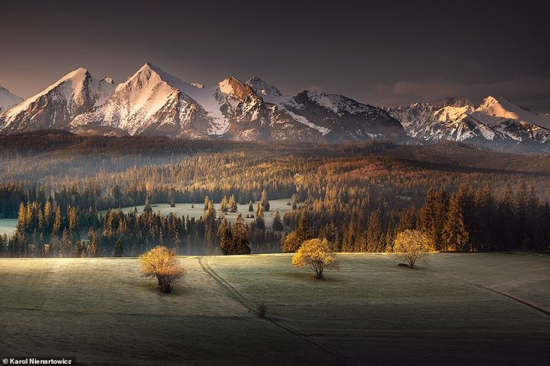 Although Karol enjoys taking images of cities, he much prefers snapping landscape shots. He explained: 'I professionally photograph mountains, so landscape is the obvious answer.' He captured this beautiful scene from the village of Lapszanka, which has a population of just 400