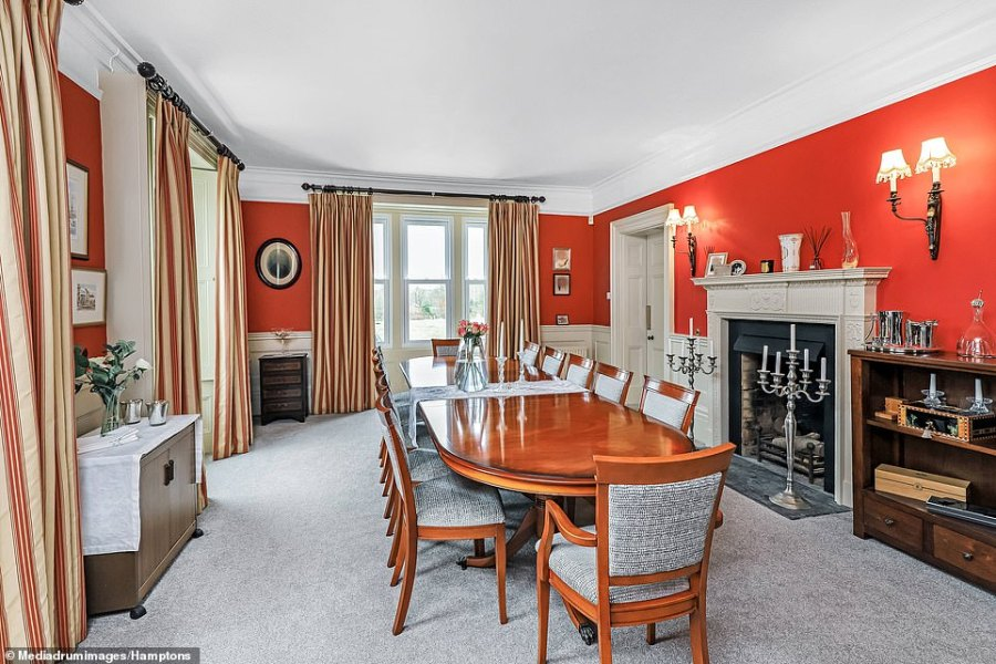 The dining room has plenty of space in which to entertain guests and large families, making it the perfect home for someone with money to spend