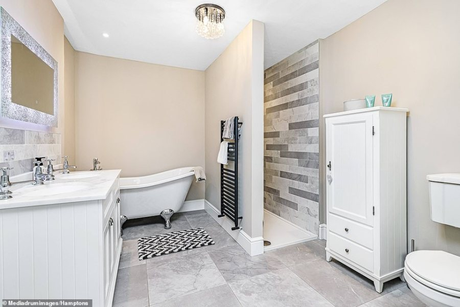As with the rest of the property, the bathroom has been updated with modern furnishings, will not be to everyone's taste