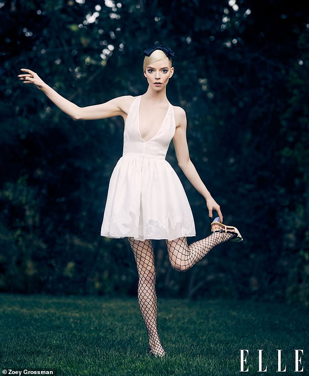 Gorgeous: Anya Taylor-Joy looked incredible in a plunging white mini dress and pink tulle creation for an ELLE fashion shoot after teasing a Queen's Gambit sequel