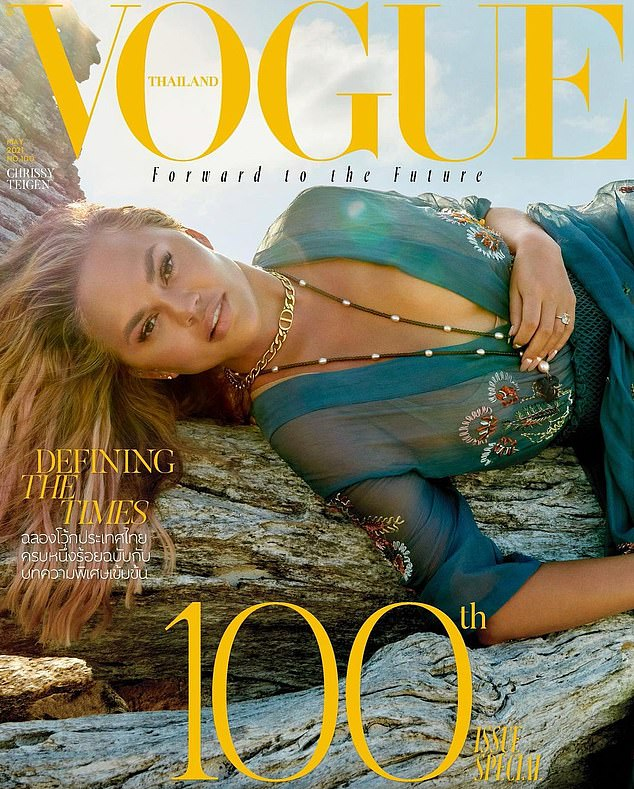 Aglow:Chrissy Teigen was a sheer delight in a see-through blue dress as she lounged by the beach in the Maldives for her new Vogue Thailand cover