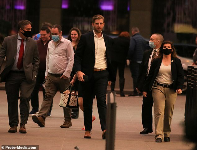 Eric Trump is seen in New York City, with his security detail - still paid for by U.S. taxpayers