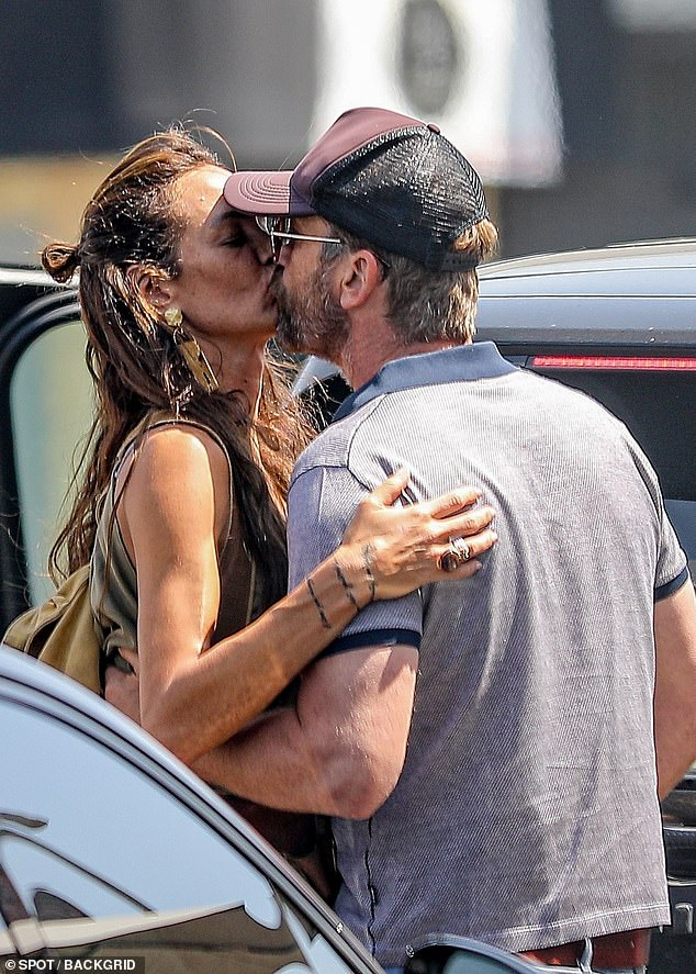 PDA alert! Attorney-turned-action star Gerard Butler passionately kissed real estate investor/interior designer Morgan Brown following their brunch date at the Kings Road Café in West Hollywood on Thursday