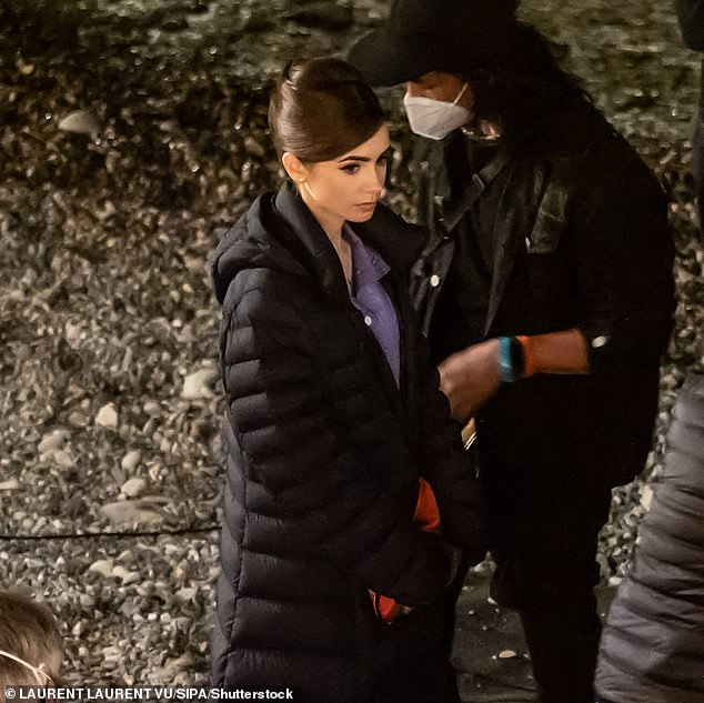 Night shoot: Lily Collins, 32, was spotted on set Thursday night in Saint-Jean-Cap-Ferrat in the South of France as she got made up to film a scene for season two of Netflix's Emily In Paris