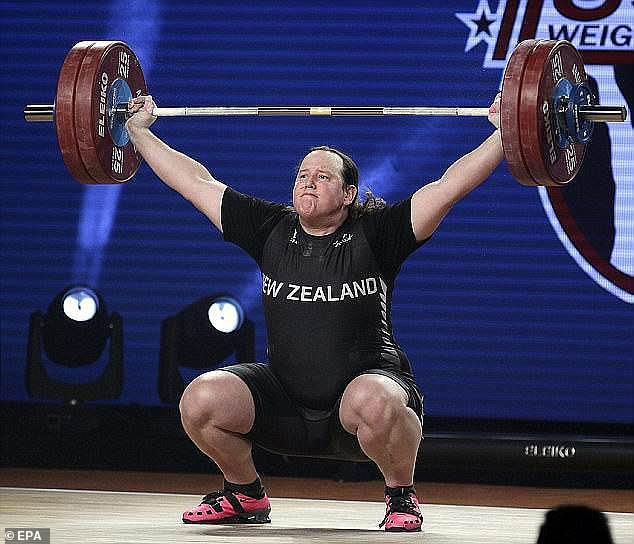 LaurelHubbard, 43, was born male but transitioned to female in her 30s. She competed in men's weightlifting competitions before transitioning in 2013. Pictured:Laurel Hubbard, post transition, in 2017 competing during the world championships in the women's competition