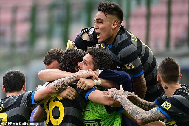 Martinez celebrating a goal with his Inter team mates in a recent Serie A win over Verona