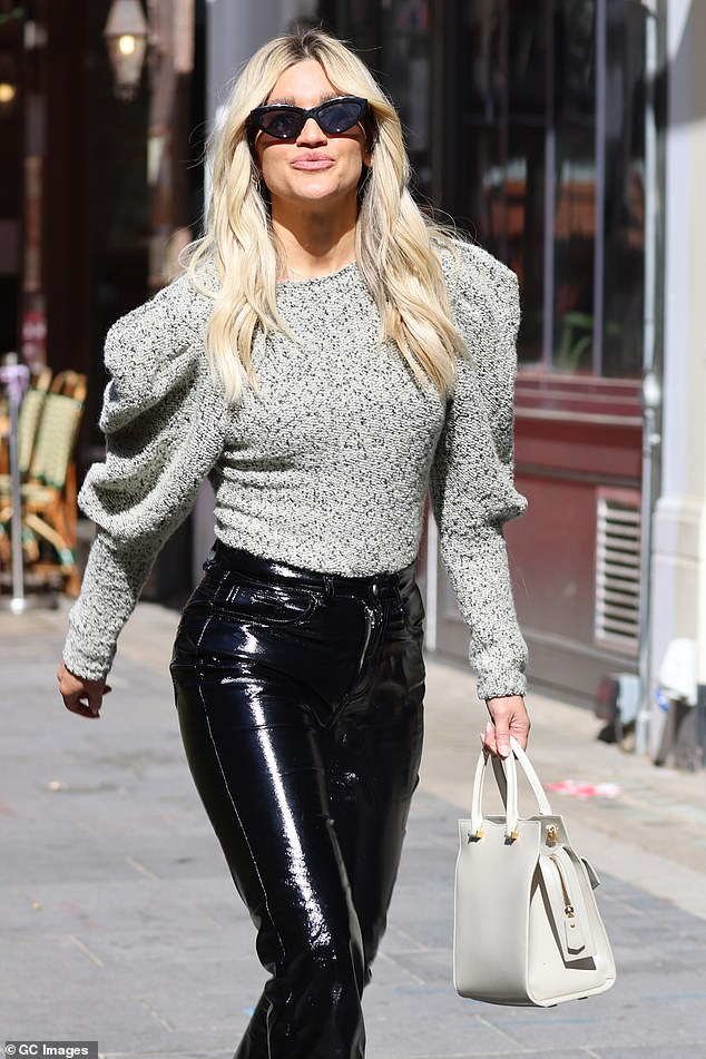 A vision:The blonde bombshell wore her tresses in loose waves that cascaded around her shoulders as she strolled through the city in the chic ensemble