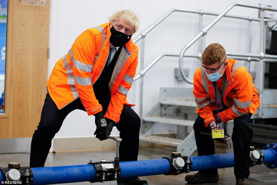 Boris Johnson helped with fixing a leak pipe on his post-election visit to Coventry this afternoon, as he celebrates a stunning set of Super Thursday results