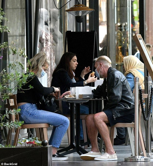 Recovery: Paul Gascoigne sat down for lunch with his personal manager Katie Davies in Milan on Friday after his early exit from the TV show L'Isola dei Famosi with a shoulder injury
