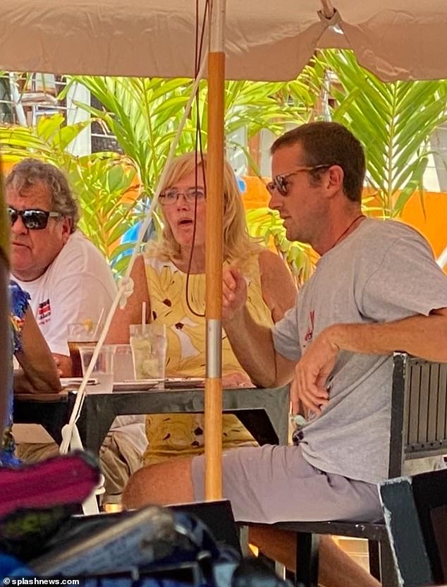 Spotted: Sporting a shorter haircut, the Social Network star cut a casual figure in a T-shirt and shorts as he met with a group of five friends at Macabuca on Grand Cayman on Wednesday