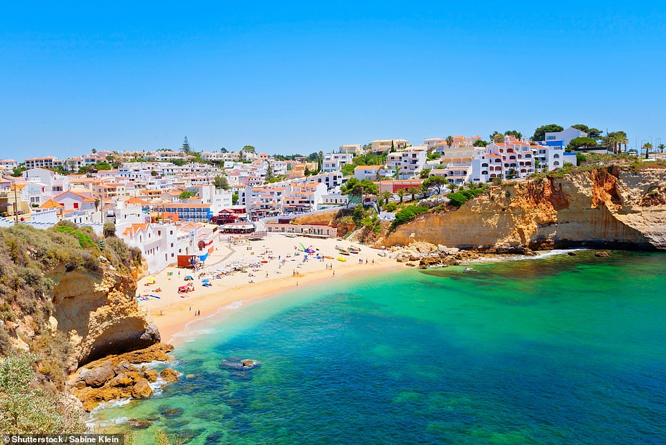 Carvoeiro village in Algarve, Portugal.Eager British holidaymakers rushed to book last minute getaways after the handful of quarantine-free destinations were unveiled by Grant Shapps at a Downing Street briefing tonight
