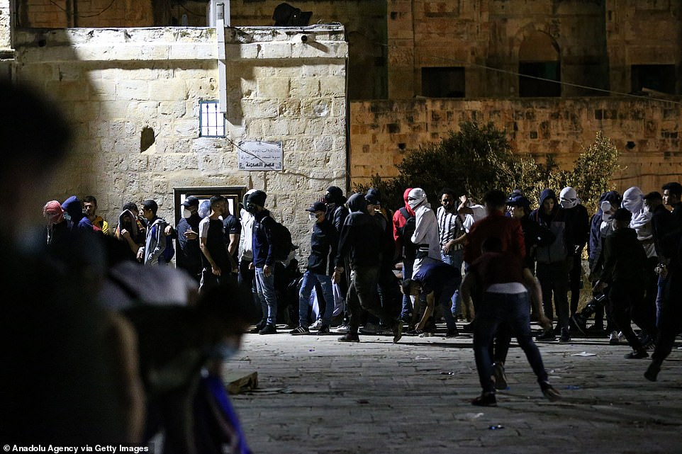 Crowds of Palestinian protesters gathered outside the mosque to celebrate Ramadan
