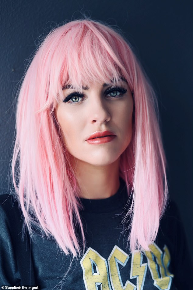 Dramatic! Booka looked almost unrecognisable as she ditched her signature blonde locks in favour of pastel pink wig for a photoshoot