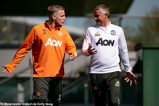 United boss Ole Gunnar Solskjaer (R) has continued to insist Van de Beek's chance will arrive